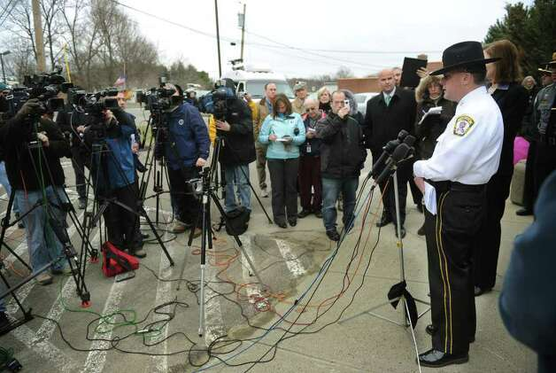 Orange Police Chief Robert Gagne addresses the media outside the Orange Police Department on Wednesday, March 23, 2011. News that 13 year-old Isabella Oleschuk was found safe after three days, hiding in the garage of an abandoned farm stand Indian River Road in Orange, Conn. ended the intensive search for the girl. Photo: Brian A. Pounds / Connecticut Post