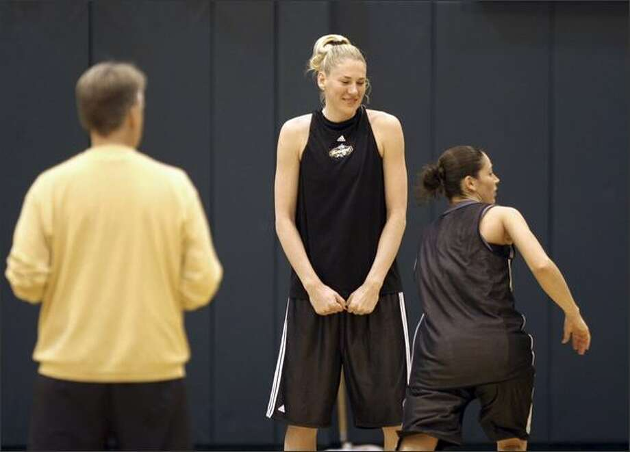 Storm coach Brian Agler watches Lauren Jackson, center, and Sue Bird at practice Wednesday. The team opens the regular season Saturday at KeyArena against Chicago. Photo: / Associated Press