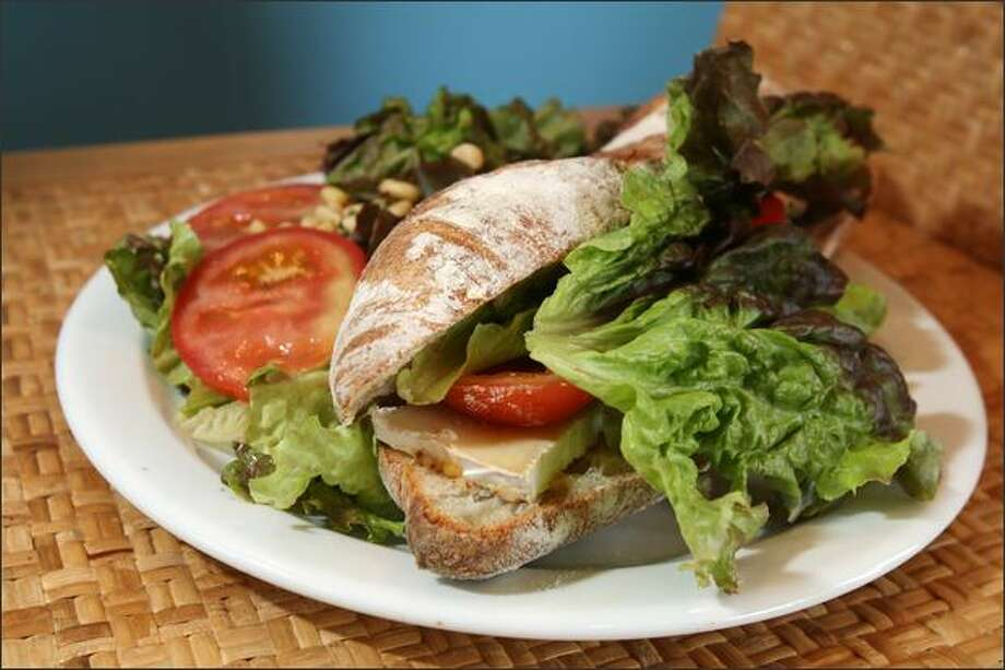 The Caprese sandwich ($6.50) is made with house-made rustic bread stuffed with mozzarella, tomato and basil, then grilled. Photo: Karen Ducey/Seattle Post-Intelligencer