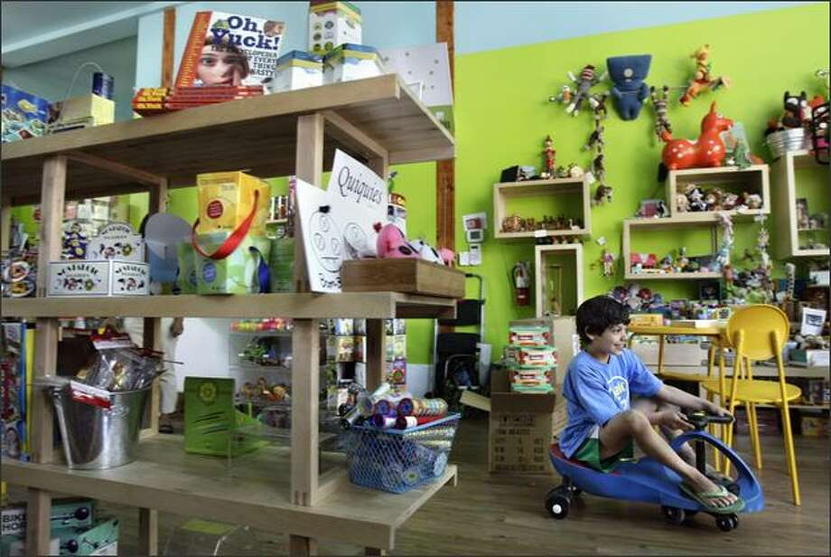 Alejandro Frederickson, 7, drives a PlasmaCar, which is propelled by body movement, while visiting Precocious, a boutique toy store in Madrona. Photo: Andy Rogers/Seattle Post-Intelligencer