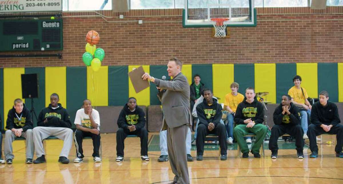 John Cook, the acting principal at Trinity Catholic High School, addresses the students during a pep rally for the state champion boys basketball team at Trinity Catholic in Stamford, Conn. on Wednesday March 23, 2011.