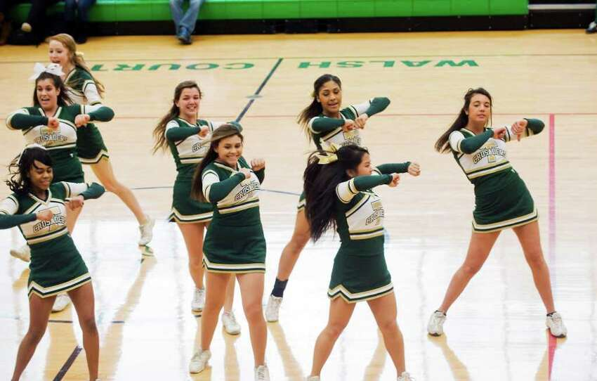 The Trinity Catholic cheerleaders perform during a pep rally for the state champion boys basketball team at Trinity in Stamford, Conn. on Wednesday March 23, 2011.