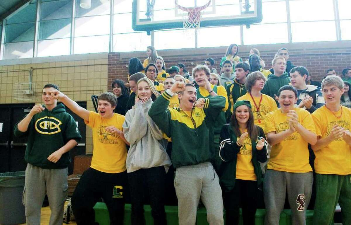 Members of the senior class cheer on the team during a pep rally for the state champion boys basketball team at Trinity Catholic in Stamford, Conn. on Wednesday March 23, 2011.