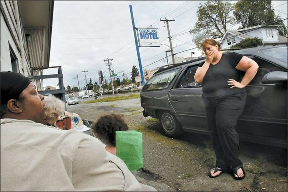 Stephanie Morris, right, talks with Yvette Dailey and other residents of the Green Lake Motel on Monday about their situation as they defy orders to vacate. Photo: Andy Rogers/Seattle Post-Intelligencer
