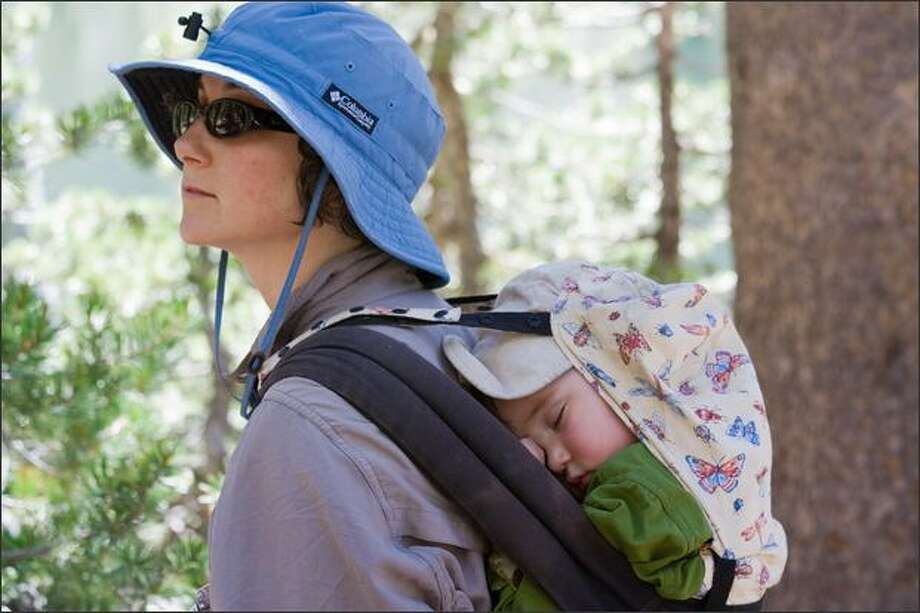 Rachel Konrad's nearly 2-year old son, Levi, takes a nap while Mom hikes in Yosemite National Park. Photo: / Associated Press