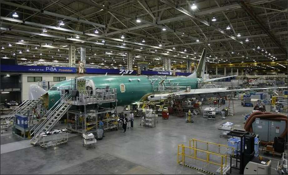 Workers assemble a P-8A Poseidon at Boeing's Renton facility Tuesday. The Navy is using the Poseidon to replace its P-3C aircraft. Photo: Andy Rogers/Seattle Post-Intelligencer