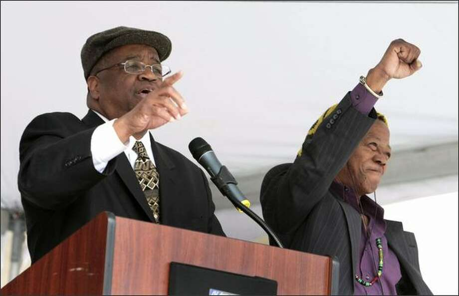 King County Councilman Larry Gossett, left, speaks in the UW's Red Square during the celebration Tuesday of four decades of diversity on the campus. Gossett and Eddie Walker, right, were both part of the Black Student Union that staged a sit-in in 1968. Photo: Meryl Schenker/Seattle Post-Intelligencer