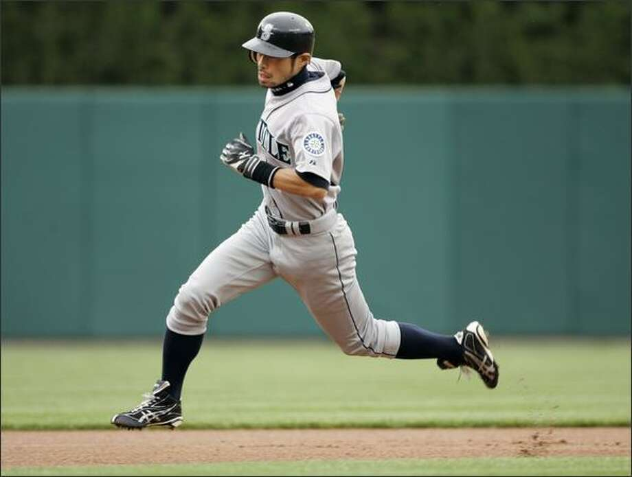 Ichiro Suzuki rounds second base and goes to third after a pick-off attempt at first base by Detroit pitcher Jeremy Bonderman got past first baseman Miguel Cabrera in the first inning. Bonderman was charged with a throwing error. Photo: / Associated Press