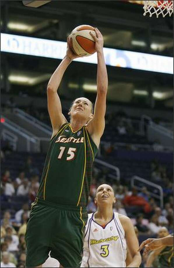 Storm center Lauren Jackson gets past Phoenix guard Diana Taurasi for two of her game-high 30 points in the first quarter as the Storm defeated the Mercury 87-83. Photo: / Associated Press