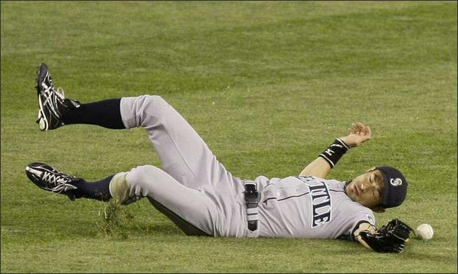 Mariners center fielder Ichiro Suzuki dives unsuccessfully for a shallow fly ball hit by Chad Moeller in the fifth inning. Robinson Cano and Jason Giambi scored on the play. Photo: / Associated Press