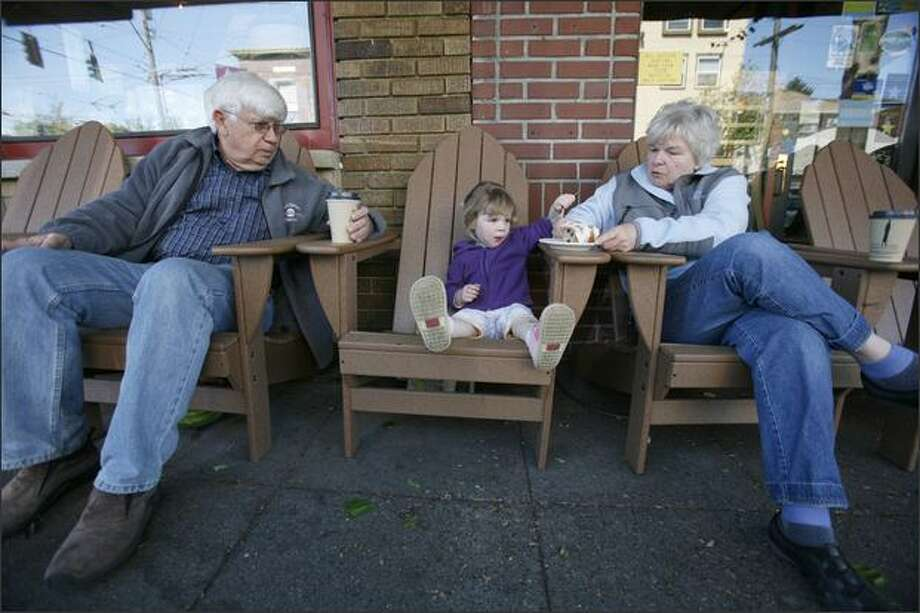 Bill and Patti Hulvershorn moved from Alexandria, Va., more than two years ago to be near their daughter and their grandchildren, including Esther, 2. The couple enjoy coffee and scones with Esther after picking her up from day care on Queen Anne. Photo: Paul Joseph Brown/Seattle Post-Intelligencer