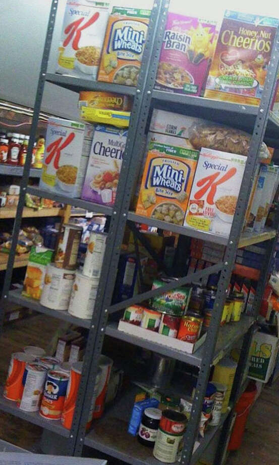 Pictured is some of the food available at the Gillespie Center's food pantry, which offers two pre-packaged bags of groceries per household on a weekly basis. In addition to weekday hours, it will now be open for two hours on Saturdays. Photo: Contributed Photo / Westport News