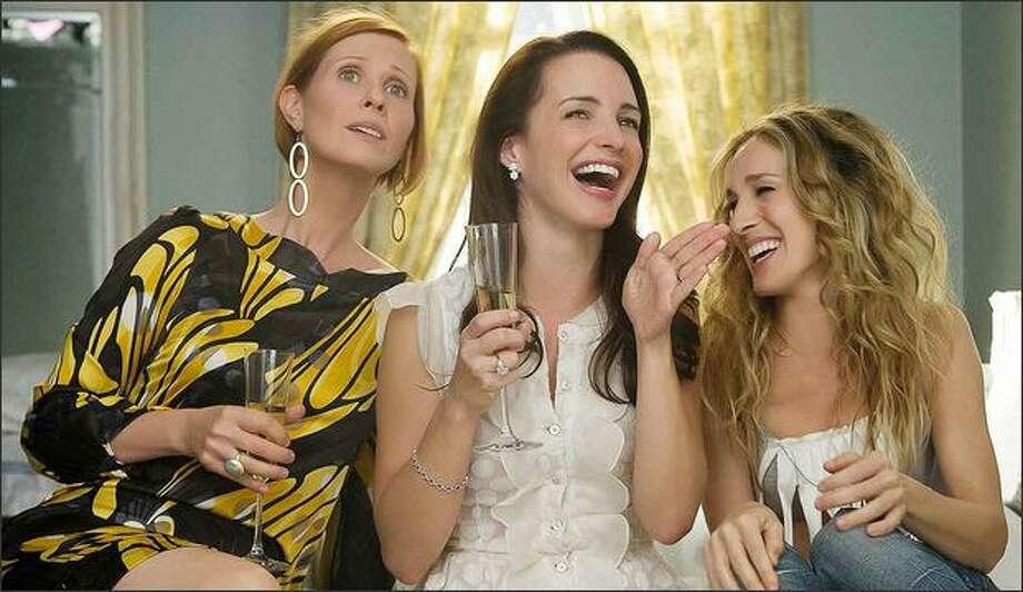 Miranda (Cynthia Nixon, left), Charlotte (Kristin Davis, center) and Carrie (Sarah Jessica Parker) share a girls' moment. Photo: / New Line Cinema