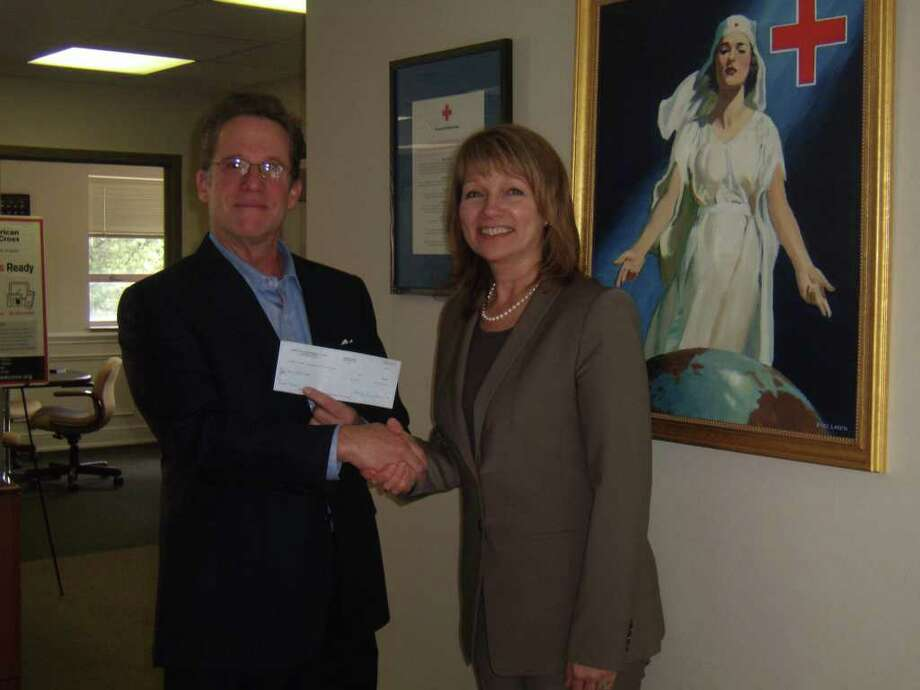 John Frank, vice chairman of Sidney Frank Importing Company of New Rochelle, N.Y., presented a check for $100,000 to Mary Young, CEO of the Greenwich Connecticut Chapter of the American Red Cross. The money is earmarked for the Japan Earthquake Relief Fund. Photo: Contributed Photo / Greenwich Time Contributed