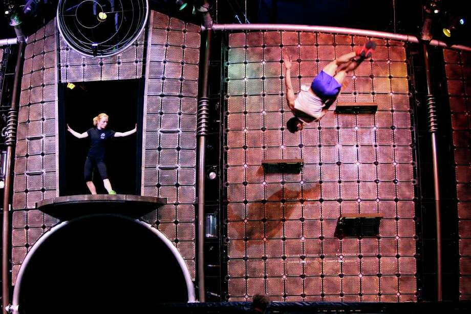 Marina Vorobyeva and Alex Cuenca rehearse on the trampoline on Wednesday March 23, 2011 for  Dralion by Cirque du Soleil performances.  The show will run through Sunday. Performers hail from 14 different countries and it takes seventeen trucks to transport the stage, props, costumes and other gear to the shows. Photo: HELEN L. MONTOYA, HELEN L. MONTOYA/hmontoya@express-news.net / SAN ANTONIO EXPRESS-NEWS