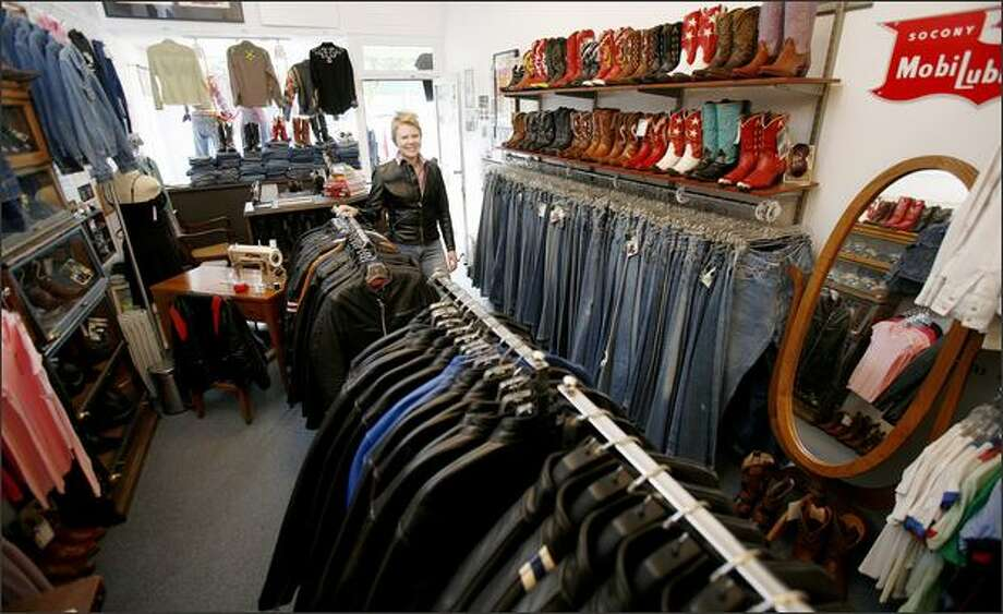Carrie Van Dyke is one of the owners of Insurrection Vintage, which sells worn leather boots and jackets. The Greenwood store claims its wares are investments. Photo: Paul Joseph Brown/Seattle Post-Intelligencer