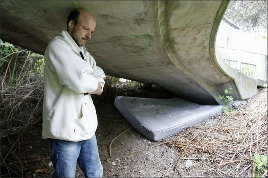 """I need a roof. I need a car. I need a job. You know that overpass down the street? I slept there the other night,"" says David Nyakas, who found a mattress in a Dumpster and took shelter under a West Seattle overpass. Photo: Mike Urban/Seattle Post-Intelligencer"