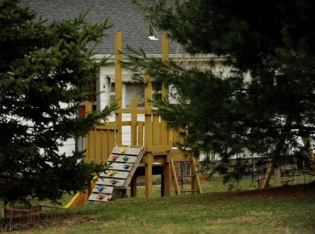 A swingset outside the home of Orange runaway Isabella Oleschuk was built by her father, according to neighbor Robert Sabia. Sabia described her parents as involved and attentive with their children. Photo: Brian A. Pounds / Connecticut Post
