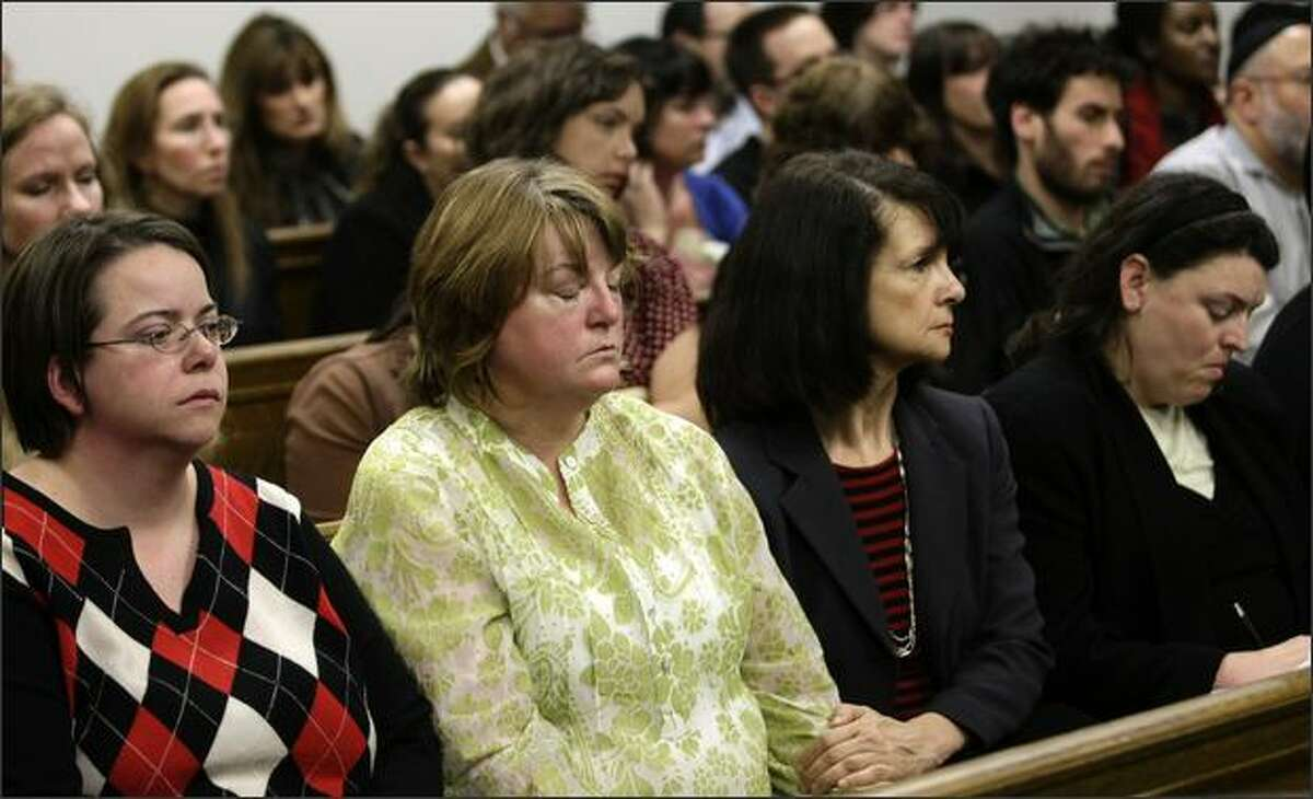Carol Goldman, left, Cheryl Stumbo, both of whom were wounded in the July 2006 shootings of the Jewish Federation of Greater Seattle, and other employees and supporters of the Jewish Federation react to the declaration of a mistrial Wednesday in the case against Naveed Haq.