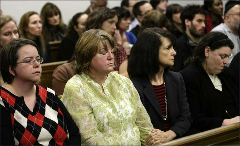 Carol Goldman, left, Cheryl Stumbo, both of whom were wounded in the July 2006 shootings of the Jewish Federation of Greater Seattle, and other employees and supporters of the Jewish Federation react to the declaration of a mistrial Wednesday in the case against Naveed Haq. Photo: Andy Rogers/Seattle Post-Intelligencer