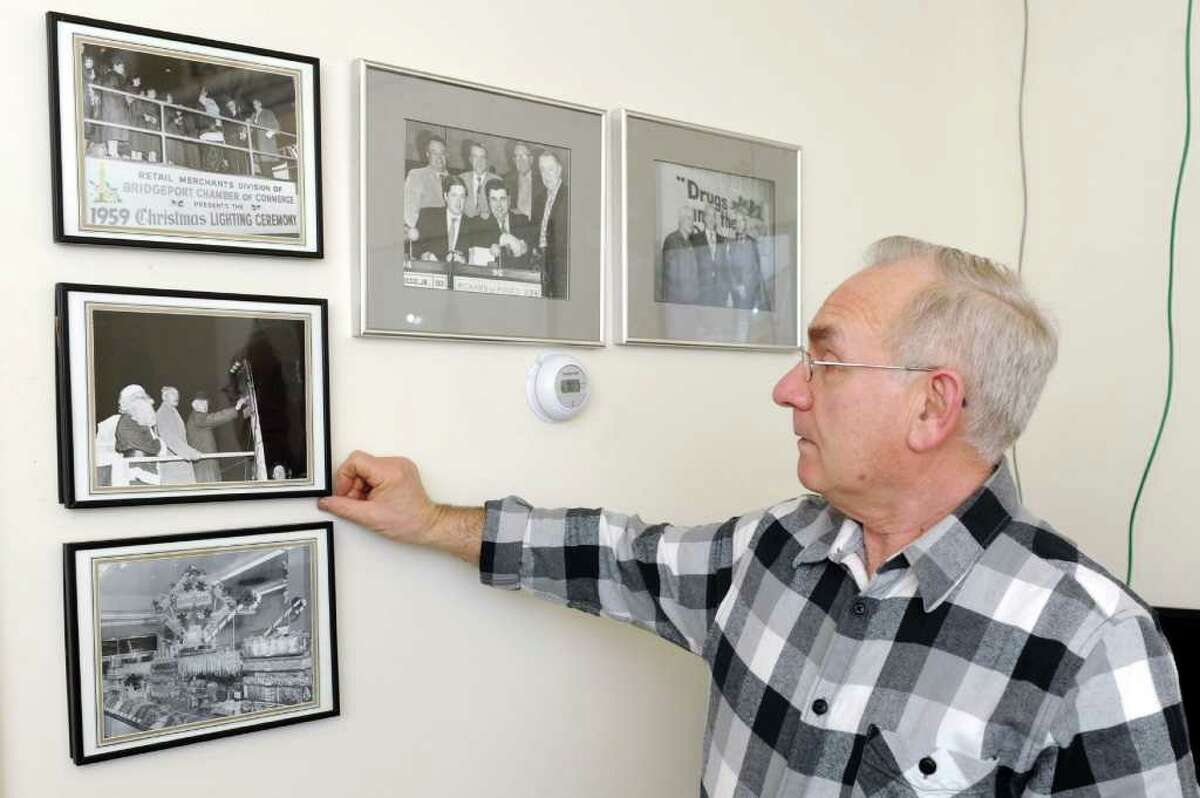 Mario Testa looks at photos of politicians on the wall of his office at Testo's restaurant in Bridgeport on Tuesday, March 22, 2011.