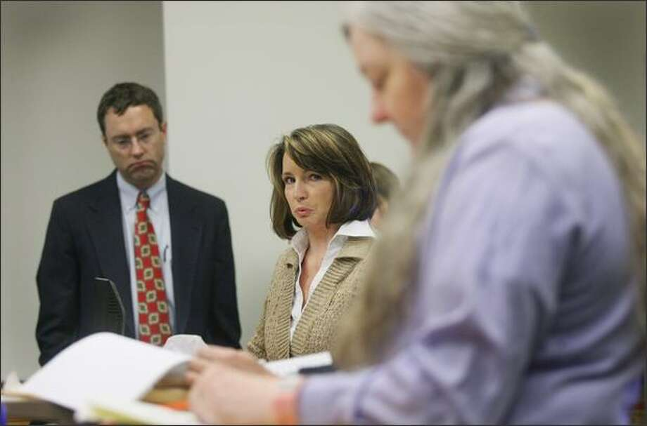 Kimberley Whitehead, daughter of murder victim Ronald Whitehead, asked the court to give Velma Ogden-Whitehead, foreground, the maximum sentence for the 2005 murder of Whitehead, Ogden-Whitehead's husband. Ogden-Whitehead was sentenced on Thursday to 22 years for the killing that prosecutors say she helped plan. On left is Craig A. Peterson, King County senior deputy prosecuting attorney. Photo: Dan DeLong/Seattle Post-Intelligencer
