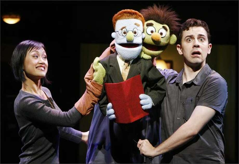 """Minglie Chen, left, and Robert McClure with puppet characters Rod and Nicky from the Tony Award-winning """"Avenue Q,"""" a jaunty, raunchy and somewhat twisted musical take on """"Sesame Street."""" Photo: /"""