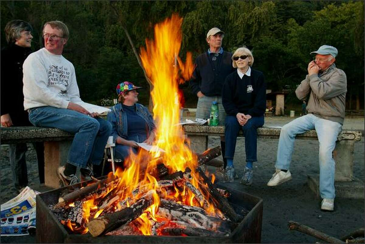 """Robert Drucker (not shown), of the Sunset Hill Community Association, says of bonfires, such as this at Golden Gardens being enjoyed several years ago: """"It's a longstanding tradition. I think people would be upset to see it go."""""""