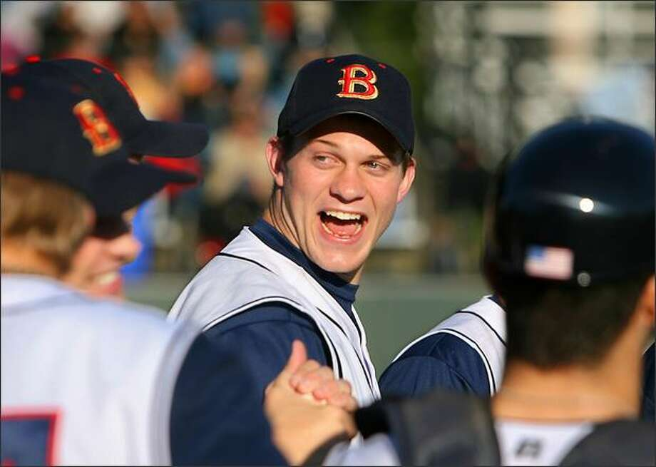 Huskies quarterback Jake Locker appears to be enjoying himself during his first game with the summer-league Bellingham Bells baseball team Friday night. Photo: Scott Eklund/Seattle Post-Intelligencer