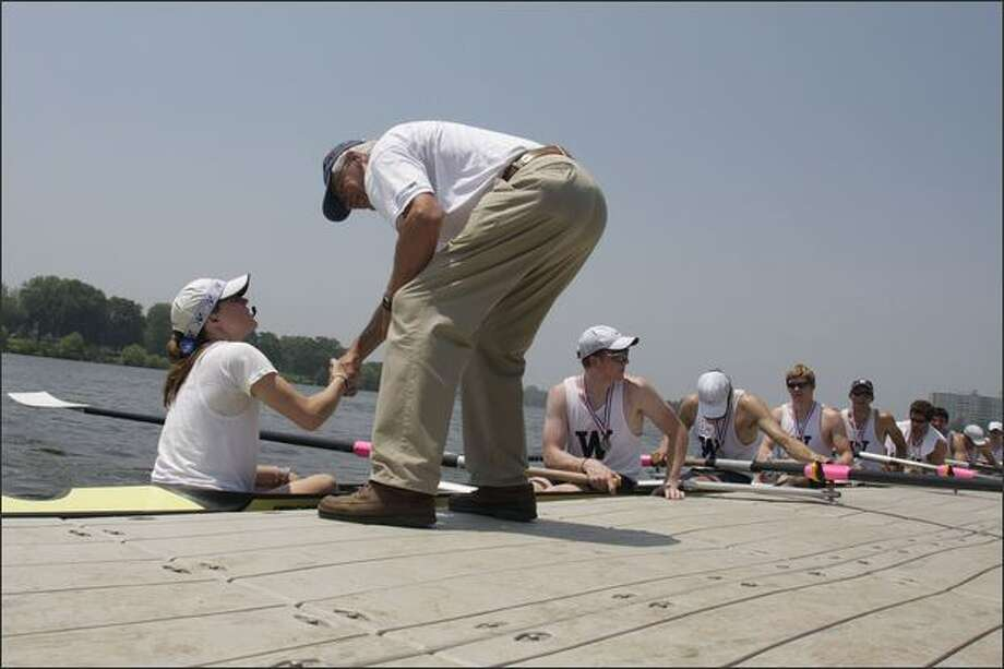 Regatta Director Clayton Chapman shakes hands with University of Washington men's varsity eight rowing coxswain Katelin Snyder after awarding the team their silver medals for the Intercollegiate Rowing Association National Championship on the Cooper River in Camden, N.J. The Washington crew was undefeated going into the finals but lost to an also-undefeated crew from the University of Wisconsin. Photo: / Associated Press