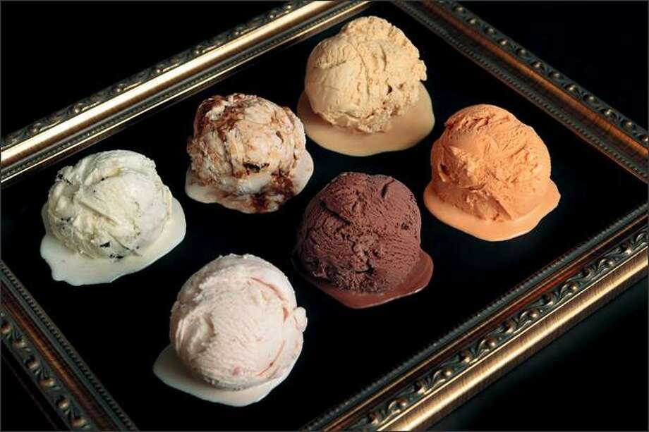 Molly Moon's Homemade Ice Cream comes in your basic strawberry and chocolate, but also Thai iced tea, bottom right, balsamic strawberry, top center, and salted caramel, top right. Photo: Meryl Schenker/Seattle Post-Intelligencer