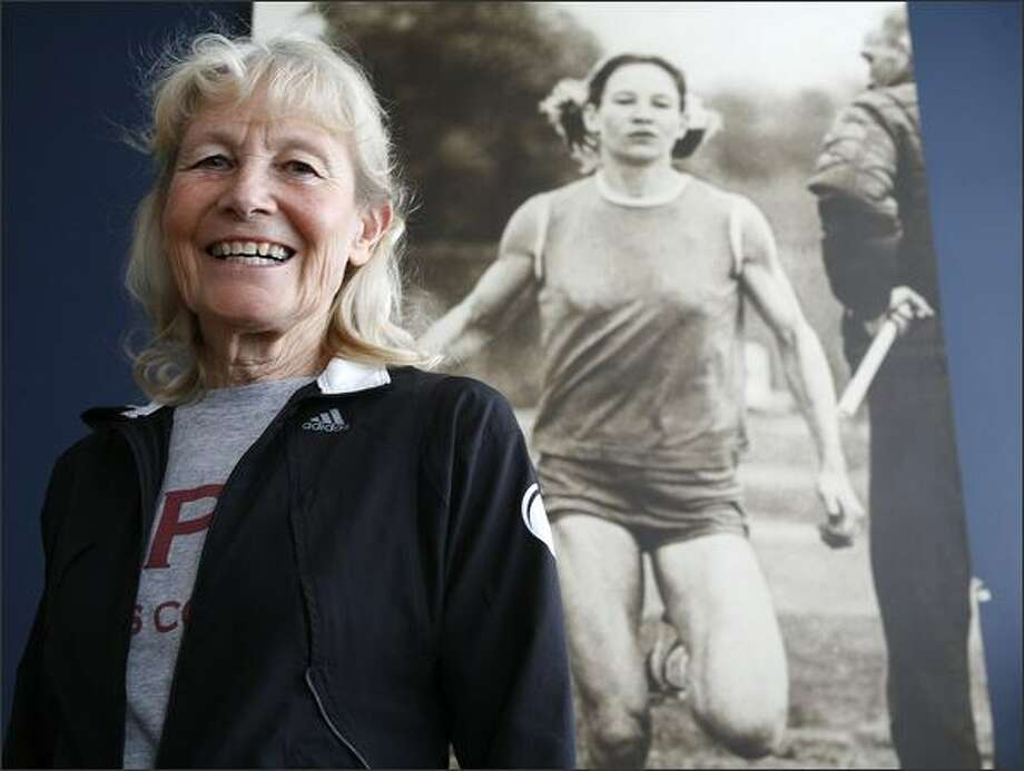 Running great Doris Heritage, 65, shown next to a photo of herself in 1966, retires this month after four decades of coaching at Seattle Pacific. She won 14 U.S. track titles and five world cross country titles in her own days as a runner. Photo: Kristine Paulsen/Seattle Post-Intelligencer