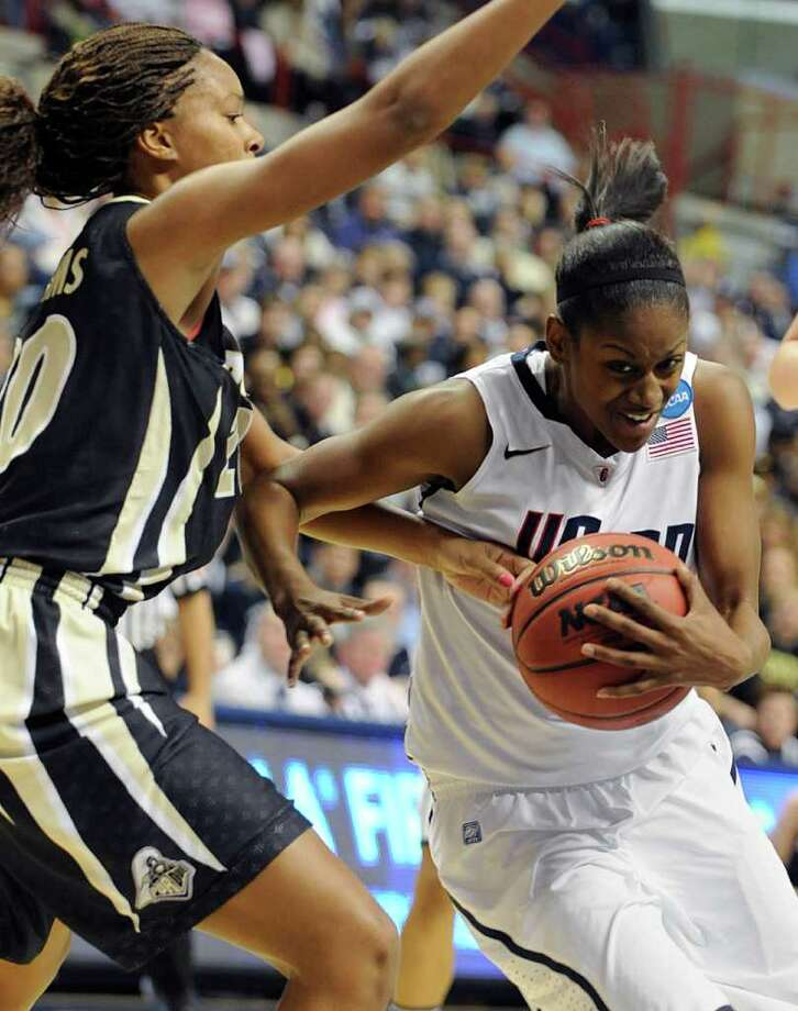 Connecticut's Tiffany Hayes, right is guarded by Purdue's Dee Dee Williams during the second half of a second-round NCAA women's college tournament basketball game in Storrs, Conn., Tuesday, March 22, 2011. Connecticut won 64-40. Hayes scored 23 points. (AP Photo/Jessica Hill) Photo: AP