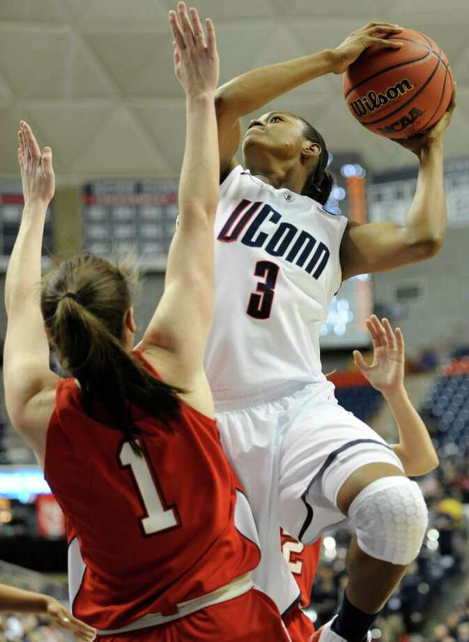 Connecticut's Tiffany Hayes, right, goes up for a basket while guarded by Hartford's Jackie Smith during the first half of an East Regional first-round NCAA women's college tournament basketball game in Storrs, Conn., Sunday, March 20, 2011. (AP Photo/Jessica Hill) Photo: AP