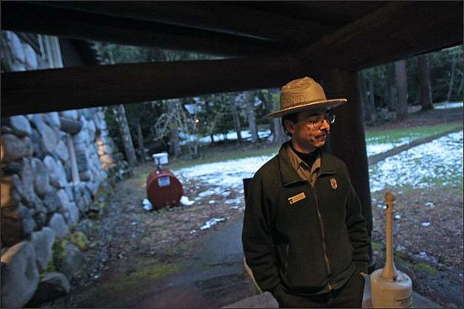 Mount Rainier National Park spokesman and park ranger Kevin Bacher briefs members of the media at Longmire on the progress of rescue and recovery attempts for three hikers, one of them deceased, on the mountain. Photo: Mike Kane/Seattle Post-Intelligencer