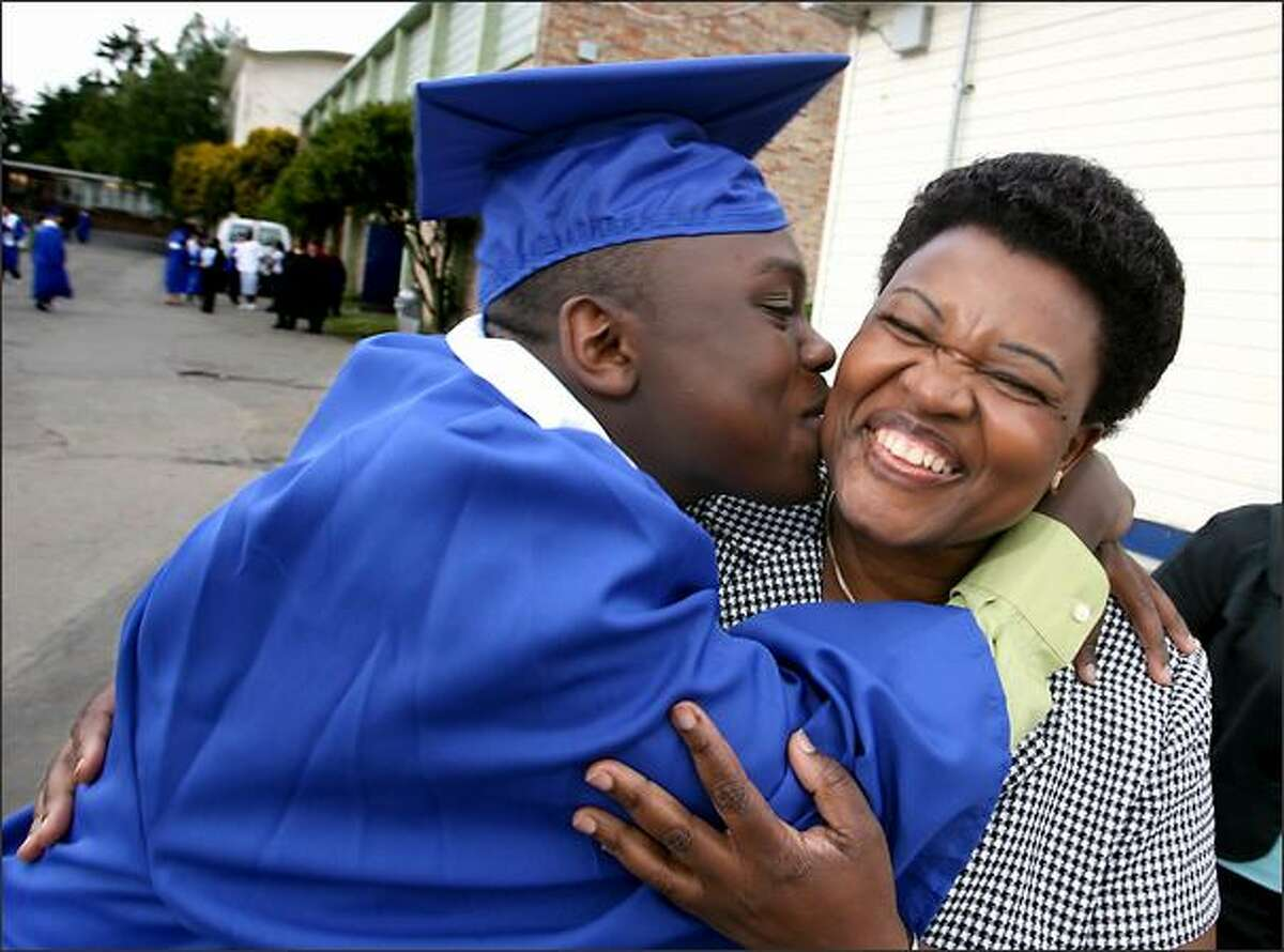 John Masembe of Ingraham High School, with his mother Susan. Despite suffering from sickle cell anemia, Masembe maintained a 3.2 GPA while working two jobs.