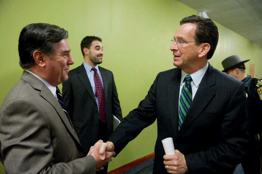 Stamford Mayor Micheal Pavia greets Governor Dannel P. Malloy as he arrives to hold one of a series of 17 town hall-style meetings across the state to discuss the budget at UCONN in Stamford, Conn., March 22, 2011. Photo: Keelin Daly / Stamford Advocate