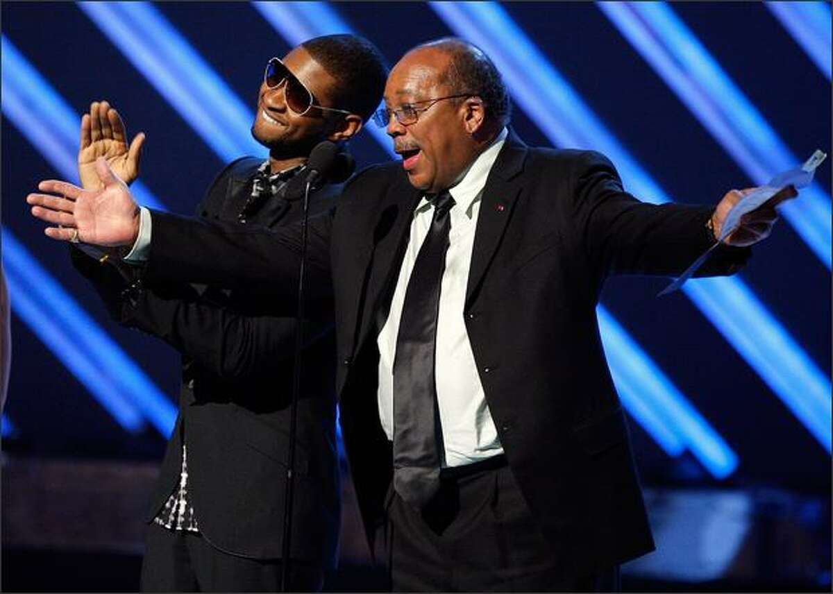 Usher joined Quincy Jones to present Album of the Year at the 50th annual Grammys earlier this year. Jones will speak at the UW.