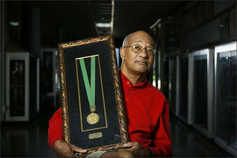 Sprinting great Charlie Greene shows the Olympic relay gold medal he won in 1968 in Mexico City. The Seattle native, 64, also earned a bronze in the 100. Photo: Michael Paulsen/Special To The P-I