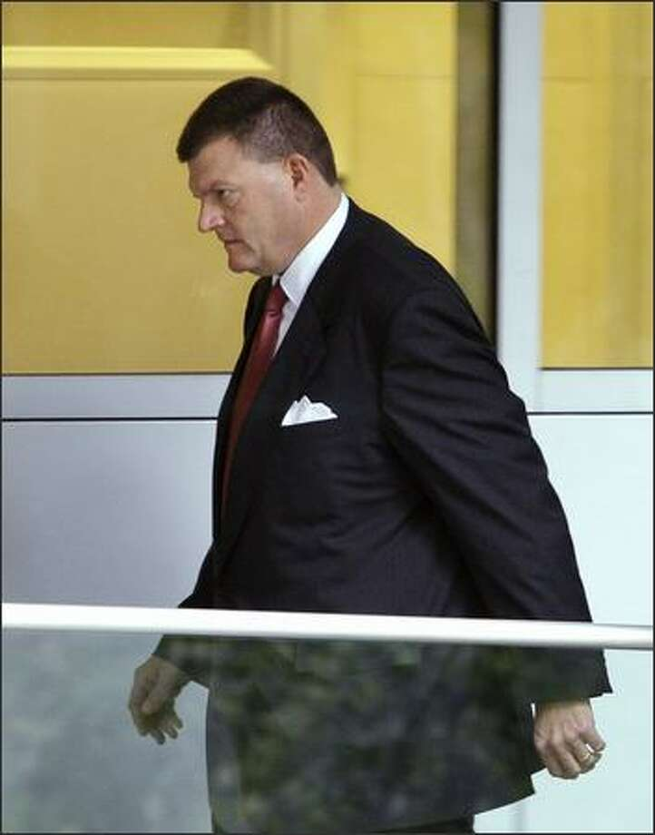 Sonics owner Clay Bennett arrives at the U.S. Courthouse on the second day of the trial between the city of Seattle and the NBA franchise. Photo: / Associated Press
