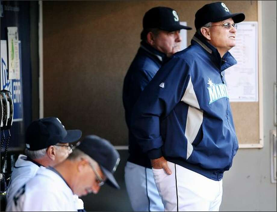 Mariners John McLaren watches the action from the dugout as the Seattle Mariners play the Florida Marlins at Safeco Field in Seattle on Tuesday. Photo: Scott Eklund/Seattle Post-Intelligencer