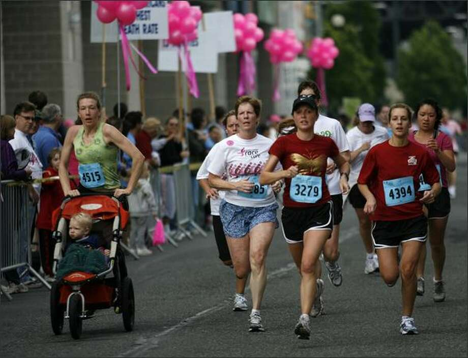 Runners make their way to the finish line at Puget Sound Susan G. Komen Race for the Cure outside of Qwest Field on Saturday. The race helps to raise money for breast cancer research, education and treatment. Photo: Kristine Paulsen/Seattle Post-Intelligencer