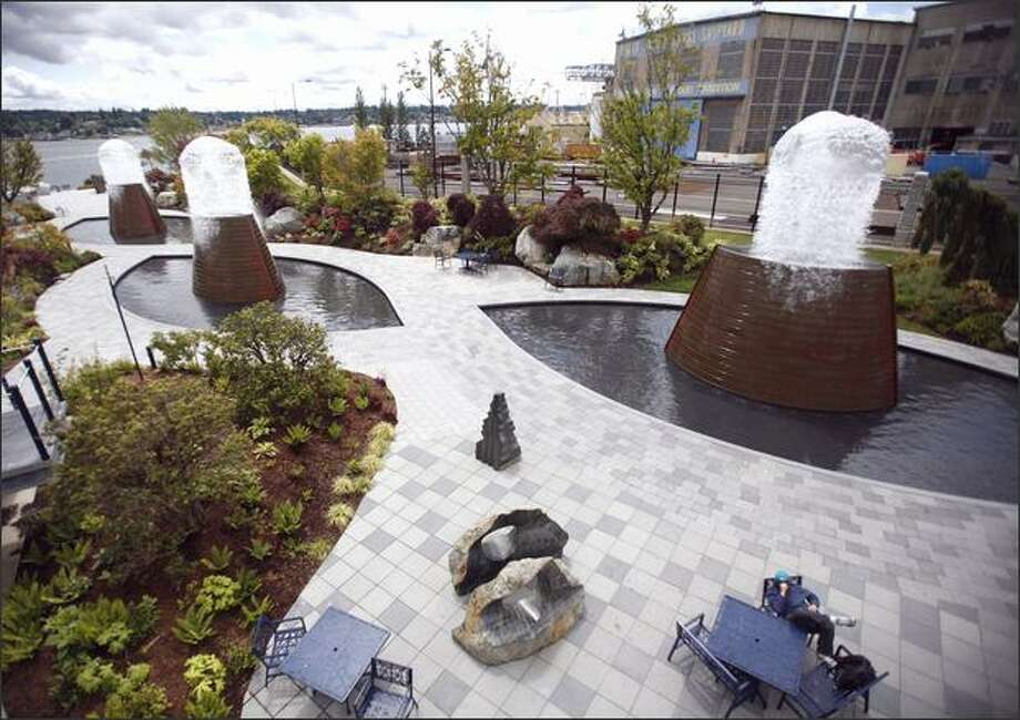 Harborside Fountain Park features a flotilla of copper-clad fountains that periodically explodes with sculpted bursts of water. Photo: Kristine Paulsen/Seattle Post-Intelligencer