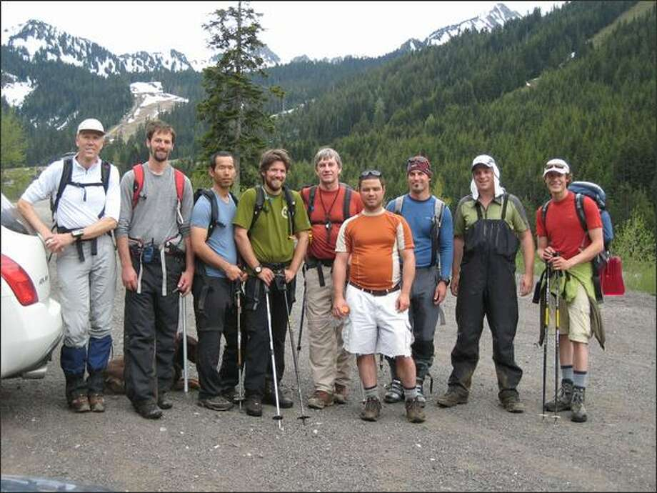 Twelve volunteers came together Saturday to search for the bodies of three missing snowboarders. Shown from left, in this picture taken by Lowell Skoog, are Skoog, Zack Treisman, Andy Toyota, Marcus Engley, Russ Schwarz, Eric Houtkooper, Justin Davis, Rob Lewis and Scott Stugelmeyer. Not pictured are Chris Willis, Joe Schaaf and Kyle Miller. Photo: /