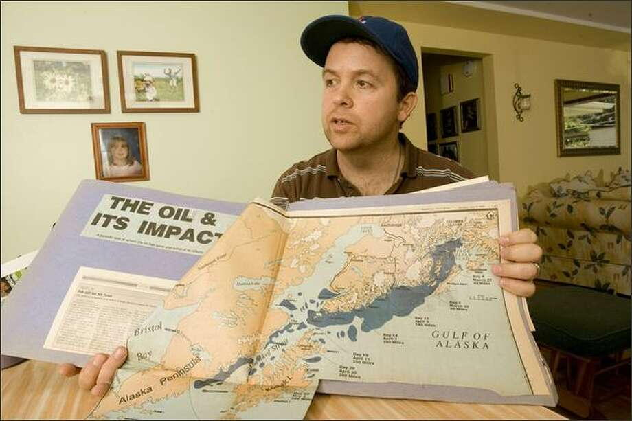 """I'm over the anger. I'm just kind of let down. It doesn't seem like justice was served,"" says William Murray, who was working on a tender when the Exxon Valdez spill happened. At his Seattle home, he shows the path of the oil spill. Photo: Grant M. Haller/Seattle Post-Intelligencer"