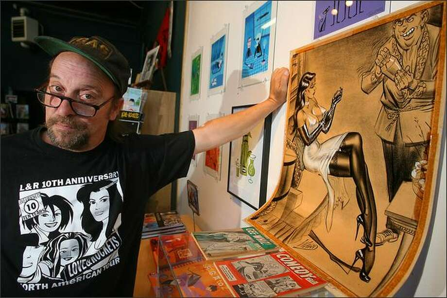 "Fantagraphics curator Larry Reid displays an original work by Bill Ward that will part of the ""Now Serving Cheesecake"" exhibit. Photo: Scott Eklund/Seattle Post-Intelligencer"