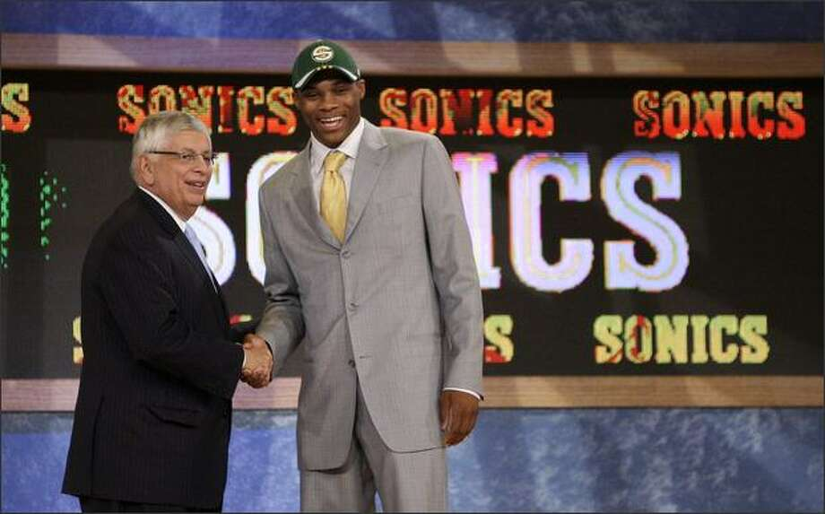 UCLA's Russell Westbrook, right, is congratulated by NBA commissioner David Stern after being picked fourth overall by the Sonics in the first round of the NBA draft Thursday in New York. Photo: / Associated Press