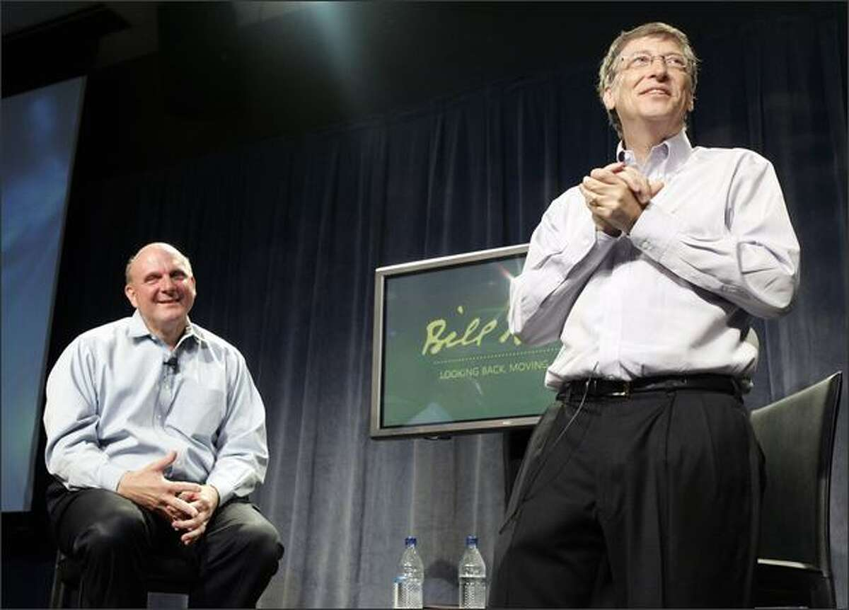 In this photo provided by Microsoft, Microsoft chairman Bill Gates, right, speaks to employees as CEO Steve Ballmer looks on during a farewell event celebrating Gates' years at Microsoft on his last day as a full-time employee, at company headquarters in Redmond.