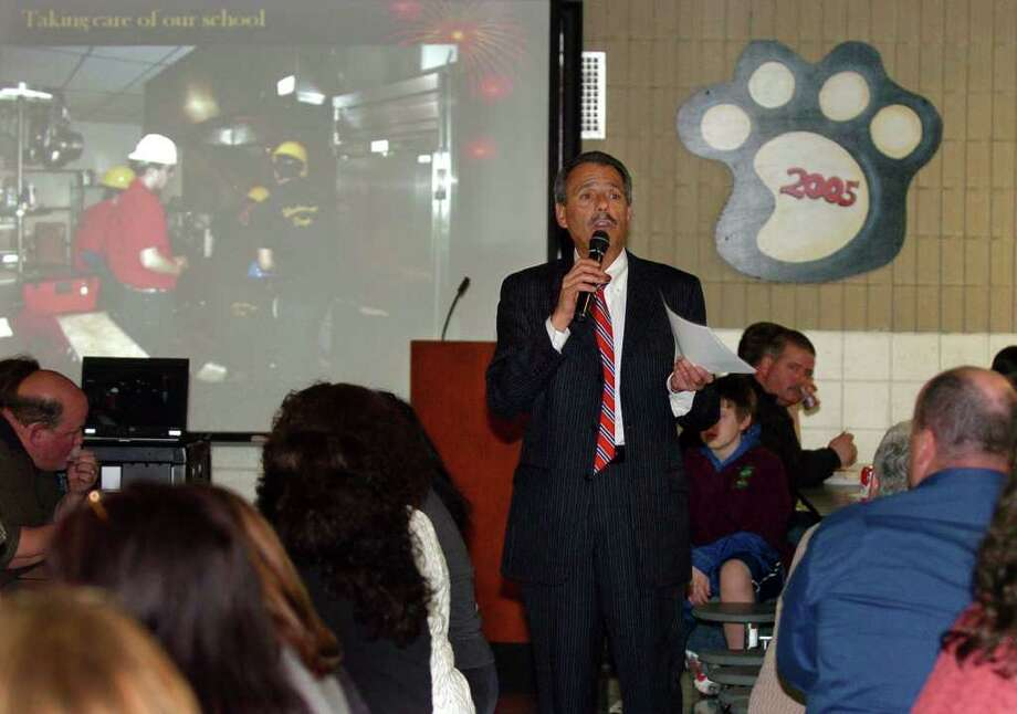 Platt Technical High School's Principal Gene LaPorta, welcomes families, local business owners, and former technical school graduates to the Family Engagement and Trade Technical Advisory Evening held at the school in Milford, Conn. on Wednesday March 23, 2011. Photo: Christian Abraham / Connecticut Post