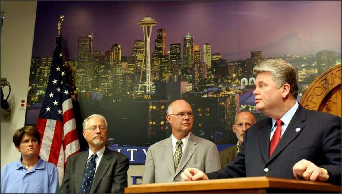 Mayor Greg Nickels, right, announces the settlement between the city and the Sonics while, from left, city council member Sally Clark, council president Richard Conlin and city attorney Thomas Carr look on Wednesday afternoon at City Hall.